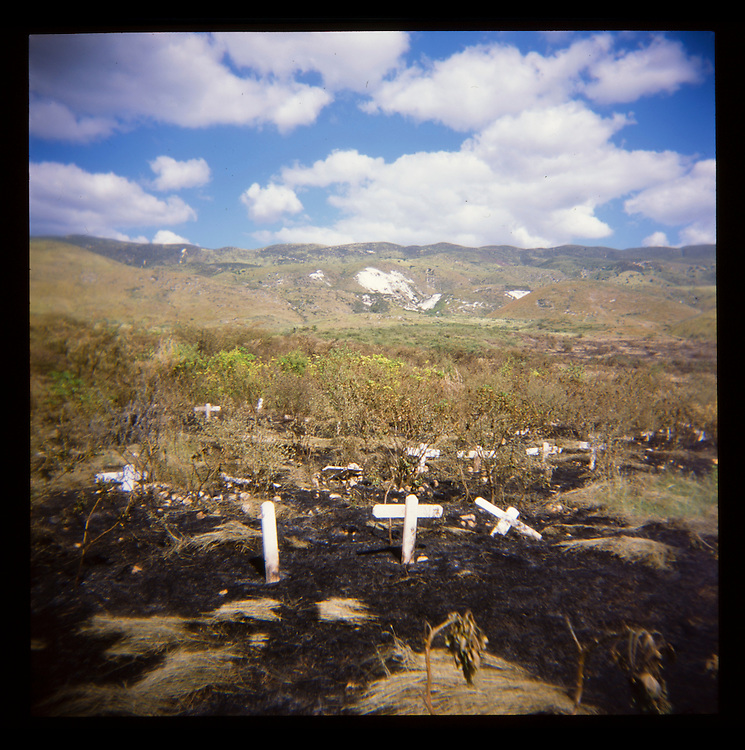 Crosses mark a mass grave site where victims of cholera and the earthquake are buried on Thursday, November 25, 2010 in Titanyen, Haiti.