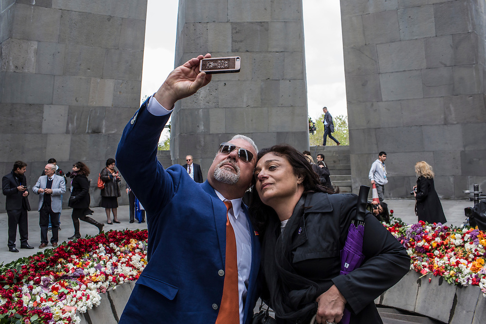 YEREVAN, ARMENIA - APRIL 24: People visit the Armenian genocide memorial after a commemoration ceremony on April 24, 2015 in Yerevan, Armenia. Armenians today are marking the one hundredth anniversary of events generally considered to be the start of a campaign of genocide against minority ethnic Armenians living in present-day eastern Turkey by the Ottoman government over fears of their allegiance during World War I. (Photo by Brendan Hoffman/Getty Images) *** Local Caption ***