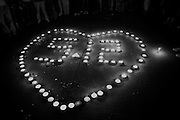 A rally by predominantly the youth contingent of Chegndu city in front of the Municipal Peoples Congress building in Chengdu. They were calling for unity amongst the peoples of the province and chanting words such as youjin (strong) and Jiaoxing Chengdu (Wake up Chengdu)..Candles were lit to form heart shaped symbols with the numbers 5-12, the date of last weeks earthquake which has to date officially killed 30,000 people..