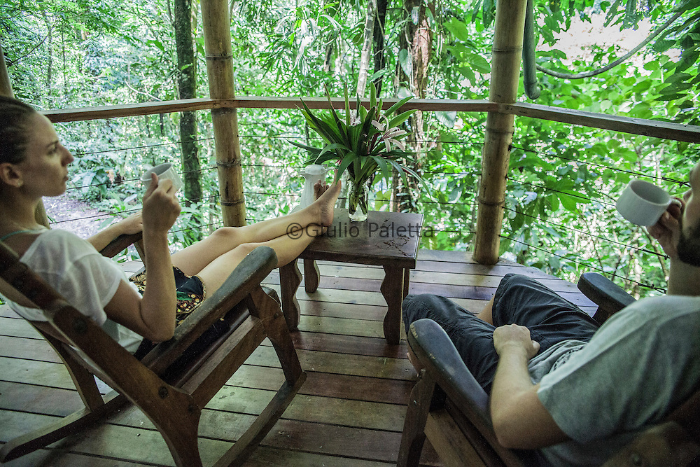 A couple of visitors enjoy the view from their tree house