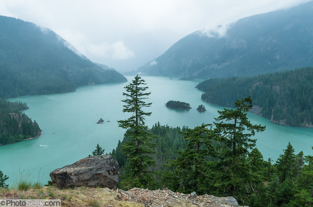 Rain falls on Diablo Lake, as seen from Diablo Lake Overlook, in Ross Lake National Recreation Area, North Cascades, Washington, USA.