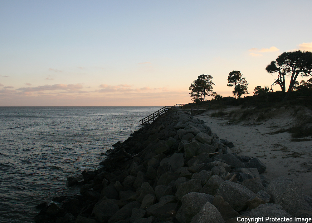 Rocky beach on the Atlantic Ocean at Jekyll Island Georgia at sunset.