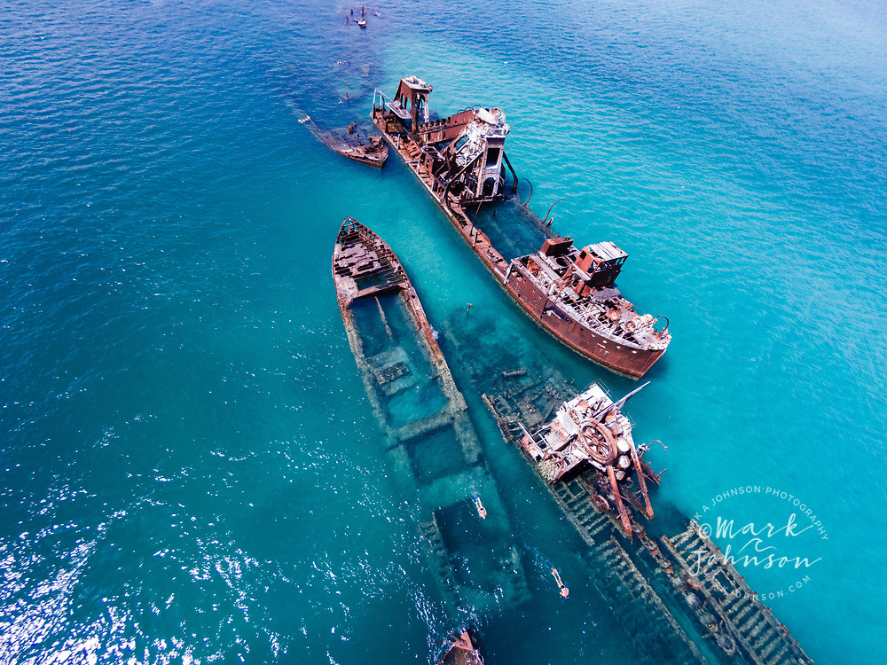 Aerial photograph of a couple snorkeling at The Wrecks, Tangalooma, Moreton Island, Queensland, Australia