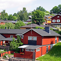 Europe, Scandinavia, Finland, Porvoo. Red houses line the Porvoonjoki river in scenic Porvoo.