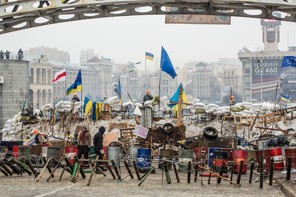 KIEV, UKRAINE - DECEMBER 13: Anti-government protesters continue to fortify their barricades intended to block the police from forcing them out of Independence Square on December 13, 2013 in Kiev, Ukraine. Thousands of people have been protesting against the government since a decision by Ukrainian president Viktor Yanukovych to suspend a trade and partnership agreement with the European Union in favor of incentives from Russia. (Photo by Brendan Hoffman/Getty Images) *** Local Caption ***
