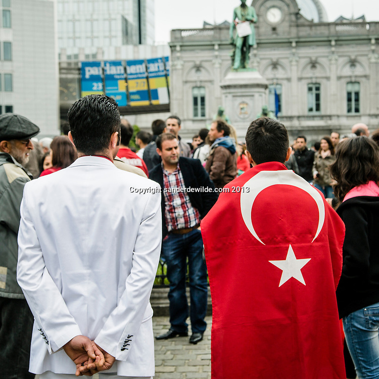 Brussel 1st  Juni 2013. A few hundred Turkish Belgiums protested at the European Parliament against Turkish prime minister Erdogan and the use of gas against demonstrators in Istanbul.Turkish young men at the demonstration in white suit and with red flag.