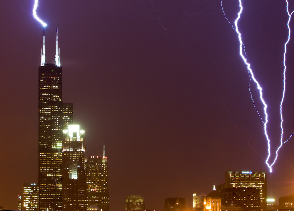 Lightning strikes the Sears (now Willis) Tower and the John Hancock building in Chicago at the same time during a freak January thunderstorm.