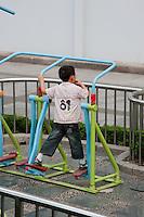 child exercising in public area in Shanghai China