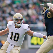 Norte Dame Junior Quarterback (#10) Dayne Crist attempts a pass while under pressure form Navy LB (#31) Jerry Hauburger. Navy defeats Notre Dame 35-17 at The New Giant's Stadium in East Rutherford New Jersey
