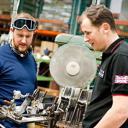 London, UK - 29 January 2013: CEO Will Butler-Adams (R) talks with a workman in the Brompton Bicycles factory in South West London. The company was founded in 1976 by Andrew Ritchie and is one of only two major frame manufacturers still based in the UK. Today, Bromptons are sold in 42 export markets.