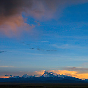 The massif of Mount Gurla Mandhata, AKA Naimona'nyi, rises at sunset above the plains of Darchen in Ngari Prefecture in western Tibet.