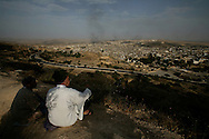 Two men  looking at Fez Medina from the Merenid Tombs hill.