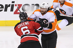 May 3, 2012; Newark, NJ, USA;  Philadelphia Flyers left wing Scott Hartnell (19) hits New Jersey Devils defenseman Andy Greene (6) during the first period in game three of the 2012 Eastern Conference semifinals at the Prudential Center.