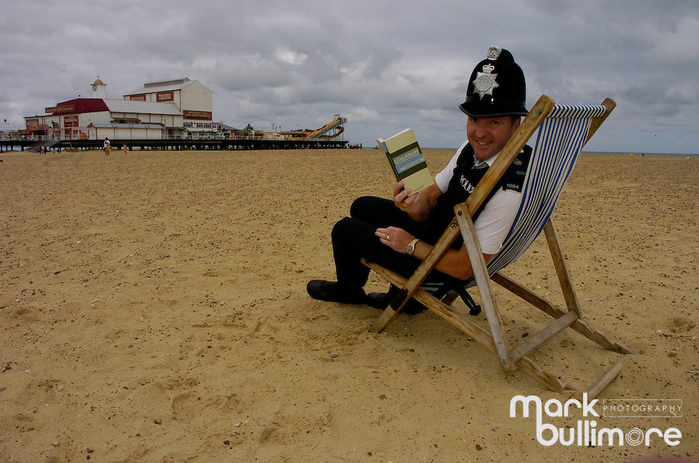 PC Gary Pettengell of Great Yarmouth (Norfolk) Police who is learning Lithuanian; for the Lithuanian workers of the town - Gary takes time out on the beach to learn the language