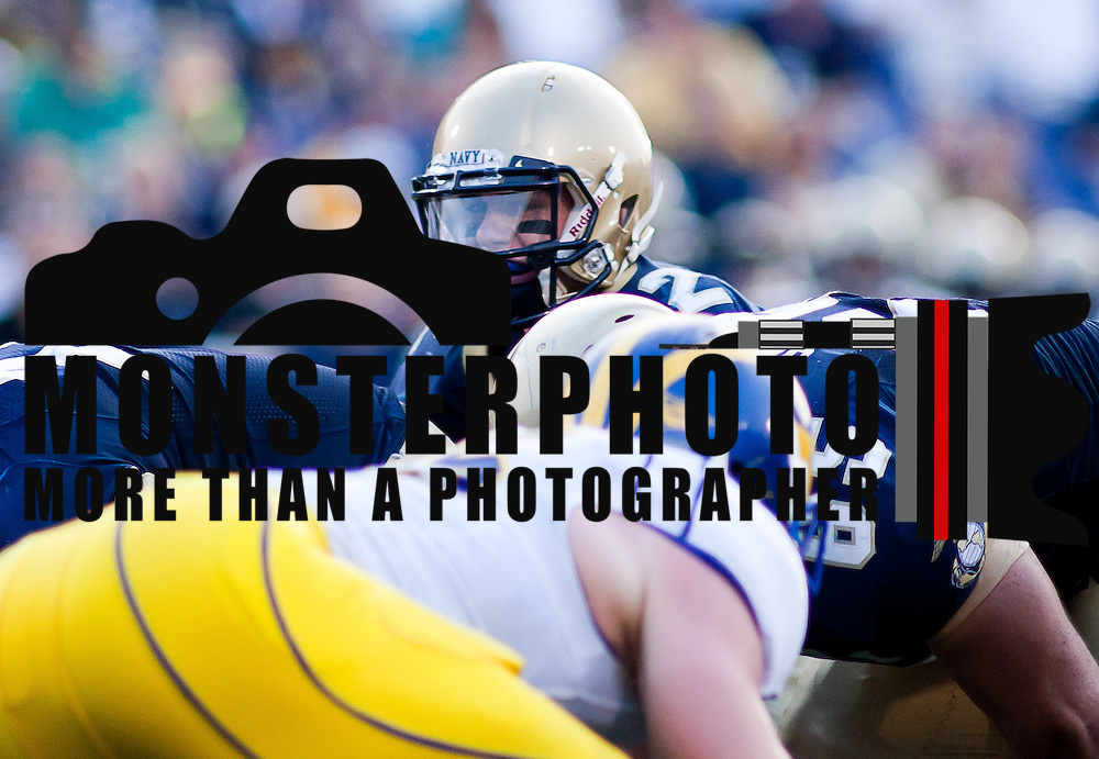 Quarterback Kriss Proctor #2 in the huddle Saturday Sept. 3, 2011 at Marine Corps Memorial Stadium in Annapolis Maryland...Navy would go on to defeat Delaware 40-17 Navy leads the all-time series against the Blue Hens, 9-7, including a 35-18 victory in 2009 when quarterback Ricky Dobbs rushed for five touchdowns.  ..Navy will hit road for a show down with Western Kentucky next Saturday Sept. 10, 2011 in Bowling Green, Ky.