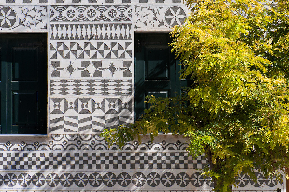 House covered with xysta (sgraffito) decorative motives in the village of Pyrgi, Mastichochoria of Chios. <br /> <br /> Pyrgi in Chios is known as the &quot;painted village&quot; on account of the decoration of the houses. The village still keeps its medieval style and together with the other Mastichochoria (Mastic Villages) are in the list of the Intangible Cultural Heritage of Humanity of UNESCO