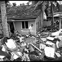 USE ARROWS &larr; &rarr; on your keyboard to navigate this slide-show<br /> <br /> Eiptya District, Sri Lanka 1 January 2005<br /> Ruins of a house after the tsunami.<br /> Photo: Ezequiel Scagnetti