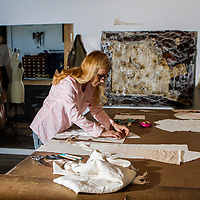 Karen Glass works on jacket in her workplace at The Goat Farm.