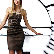 SHOT 5/7/2006 - Larimer Square 2006 spring fashion campaign. Shot in the May D&F Clocktower in downtown Denver, Co. The Daniels & Fisher (D&F) Tower is a distinctive Denver, Colorado landmark. Built as part of the Daniels & Fisher department store in 1910, it was the tallest structure west of the Mississippi at the time. Modeled after The Campanile (St. Mark's Bell Tower) at the Piazza San Marco in Venice, Italy, the clock tower has clock faces on all four sides. Daniels & Fisher were later bought out by the May Company, and in the 1950s and 60s it was known as the May D&F building. When the building was demolished (ca. 1980), the tower was saved. It stands today in downtown Denver..(Photo by Marc Piscotty/ © 2006)