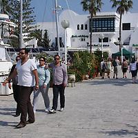 Scenes from Tunisia's resort area, El Kantouai, tourist by yacht and restaurants