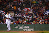 Boston, MA - Boston Red Sox batter Dustin Pedroia is caught in a rain shower in the fourth inning against the Toronto Blue at Fenway Park on Saturday, September 8, 2012.   Photo by Matthew Healey