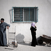 "Palestinians wait for a distribution of flour outside the UNRWA (United Nations Relief and Works Agency) warehouse in Gaza City on January 29, 2009. The United Nations will launch a 613 million dollar appeal to meet the ""massive"" needs of those hit by Israel's 22-day war in Gaza, UN chief Ban Ki-moon said."