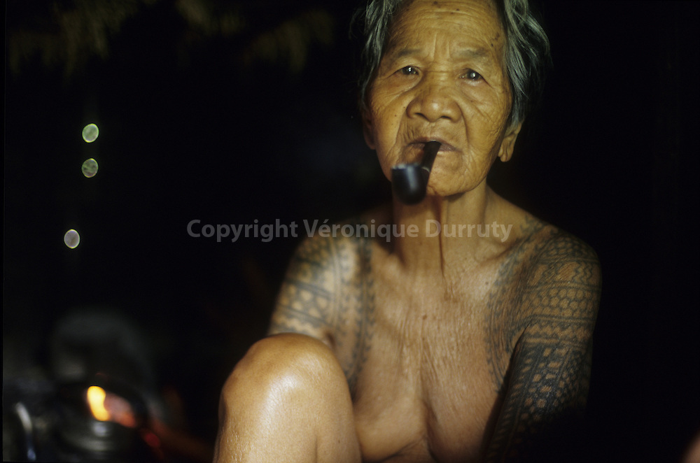 OLD KALINGA - HEAD HUNTERS TRIBE - WOMAN IN HER HOUSE,  NORTH LUZON,THE PHILIPPINES