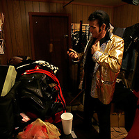 Mike Jones becomes Elvis Presley in his dressing room at The Lantern Inn, his family's restaurant in Gainesville, Ga., on Saturday, Dec. 16, 2006. Jones, 46 and a cook, has been performing as Elvis at the eatery for 18 years, but Saturday was the curtain call. The Lantern Inn closed its doors on Sunday after over 40 years of business.<br />