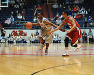 "Ole Miss' LaDarius White (10) vs. Louisiana-Lafayette's Raymone Andrews (22) at C.M. ""Tad"" Smith Coliseum in Oxford, Miss. on Wednesday, December 14, 2011. (AP Photo/Oxford Eagle, Bruce Newman)"