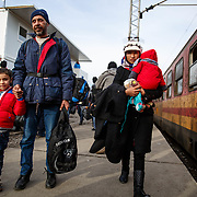 Hamood, 6, from Hama, Syria, holds his dad's hand after arriving at the Tabanovce Train Station, their stop before they cross the border into Serbia, on their way into Western Europe. Mercy Corps is among the organizations that provide critical information to refugees and arrange for and offer transport for vulnerable people, so they don't have to walk in difficult conditions. A daily average of 2,400 refugees have crossed into Serbia throughout the winter. Warmer months saw highs of 10,000 arrivals. There is no train schedule-the trains leave Gevgelija, Macedonia (at the Greece border) when they fill up, therefore over the winter two to three trains a day have been arriving in Tabanovce at varying times of day and in the middle of the night. Macedonia, January 2016.