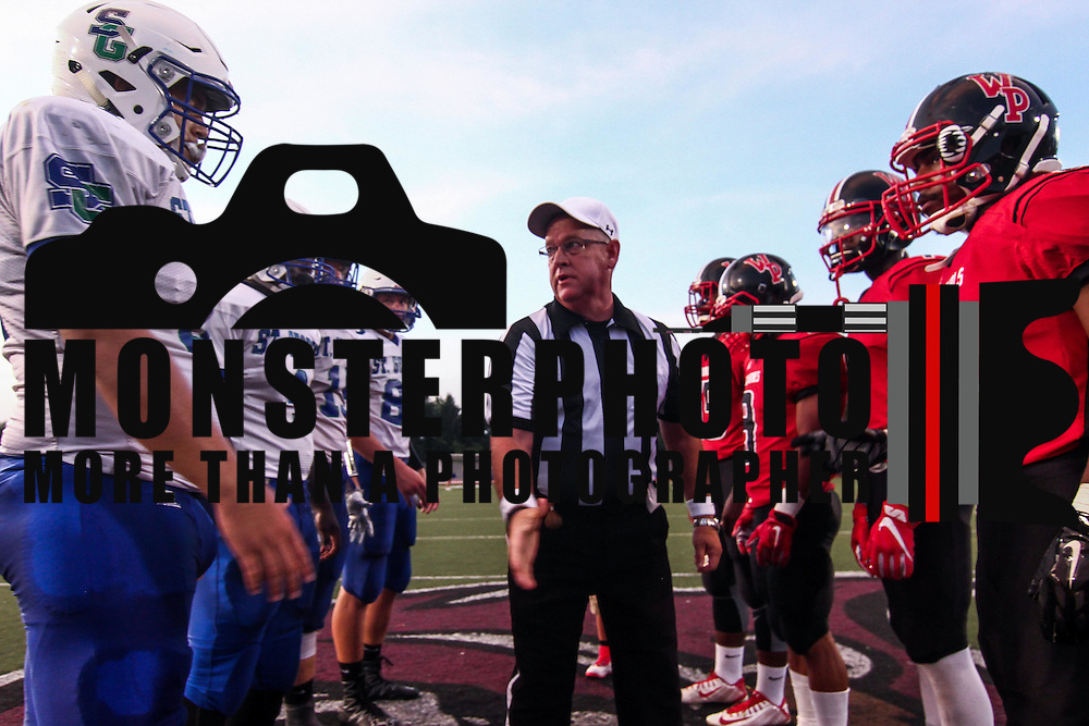 A game official provides instructions to William Penn and St. Georges players prior to a week one DIAA game between William Penn and St. Georges, Friday, Sept. 09, 2016 at CARAVEL Academy in Bear, DE.