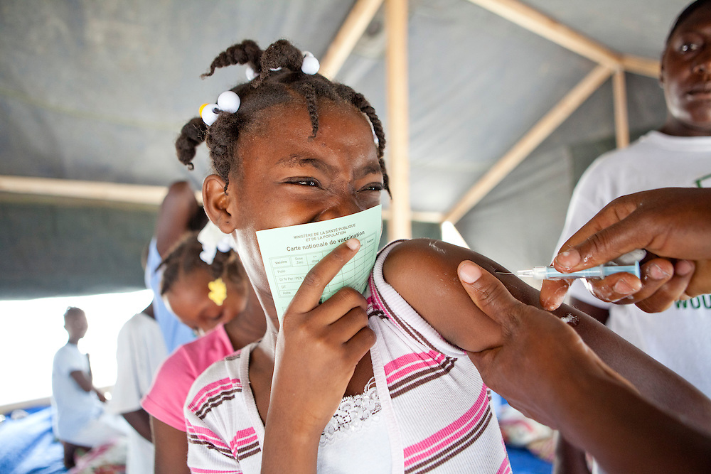Christelle Thermitus, age 11, receives an immunization for tetanus, polio, and several other diseases at the Corail-Cesselesse camp on July 12, 2010 in Port-au-Prince, Haiti.
