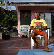 Danny Sweeney, fisherman and former windsurf teacher to rock stars, at his house he bought for a song. The tropical Caribbean island of Montserrat which has suffered badly since the eruption of the Soufriere Hills volcano 10 years ago. Two thirds of the island is out of bounds to everyone except scientists. .Photo©Steve Forrest/Workers Photos