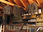 """Jackets and boxes are arrayed in the late 1800s restored Frontier Ladies Dry Goods Store in Nevada City, Montana, USA. Nevada City was a booming placer gold mining camp from 1863-1876, but quickly declined into a virtual ghost town. This fascinating town inspires you to imagination what life must have been like in early Montana when gold was discovered at nearby Alder Gulch. More than 90 buildings from across Montana have been gathered for preservation at Nevada City, mostly owned by the people of the State of Montana, and managed by the Montana Heritage Commission. In 2001, the excellent PBS television series """"Frontier House"""" used one of the buildings and its furnishings to train families in re-creating pioneer life. A miner's court trial and hanging of George Ives in the main street of Nevada City was the catalyst for forming the Vigilantes, a group of citizens famous for taking justice into their own hands in 1863-1864. Directions: go 27 miles southeast of Twin Bridges, Montana on Highway 287."""