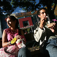 Friends have an ice cream in the Parque 93 in north Bogotá on Saturday, May 5, 2007. (Photo/Scott Dalton)