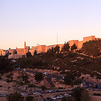 The walls of Jerusalem's Old City near the Jaffa Gate and Citadel of David overlook the Sultan's Pool and Derech Hevron in this late-afternoon panoramic view. WATERMARKS WILL NOT APPEAR ON PRINTS OR LICENSED IMAGES.
