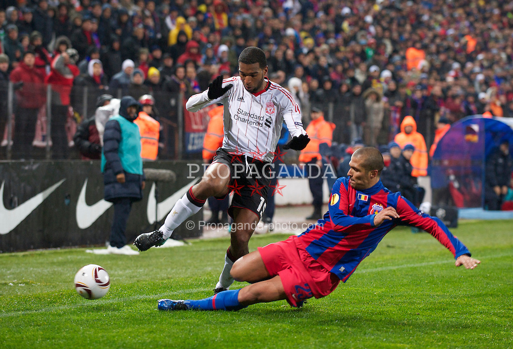 BUCHAREST, ROMANIA - Thursday, December 2, 2010: Liverpool's Ryan Babel and FC Steaua Bucuresti's Geraldo Alves during the UEFA Europa League Group K match at the Stadionul Steaua. (Pic by: David Rawcliffe/Propaganda)