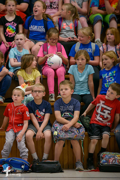 Students listen to a presentation by the Rev. Joel Fritsche, career missionary to the Dominican Republic, during a visit to his former congregation, Zion Lutheran Church and School, Staunton, Ill., for a home service visit on Wednesday, April 26, 2017, in Staunton.  LCMS Communications/Erik M. Lunsford