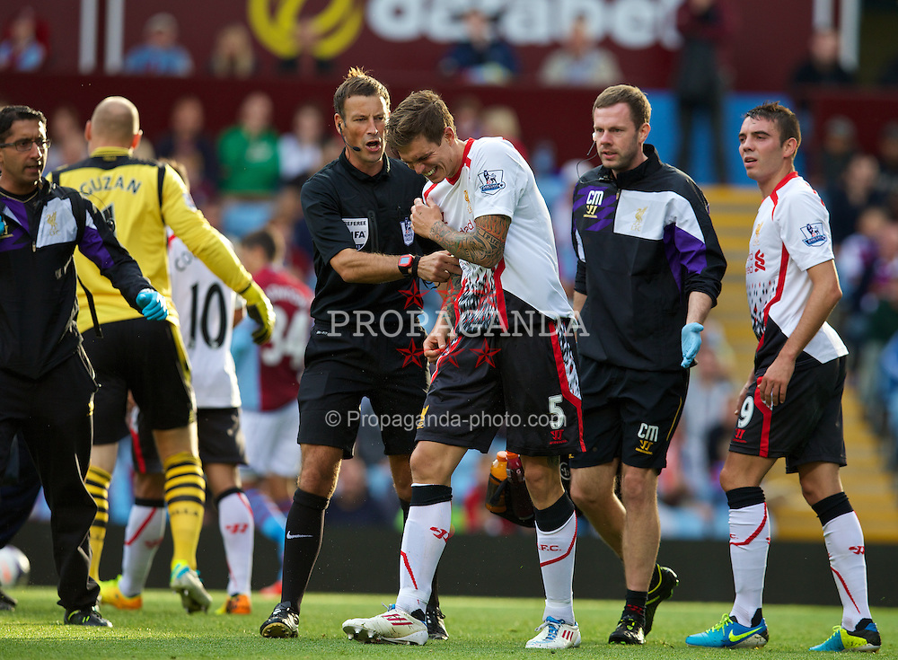 LIVERPOOL, ENGLAND - Saturday, August 24, 2013: Liverpool's Daniel Agger injured during the Premiership match against Aston Villa at Villa Park. (Pic by David Rawcliffe/Propaganda)