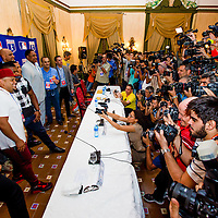 Cuban and American media swarms MLB players posing for a group shot after a presser at the Hotel Nacional de Cuba as MLB players make a goodwill trip to Havana, Cuba. (Photo by Chip Litherland/The Players' Tribune)