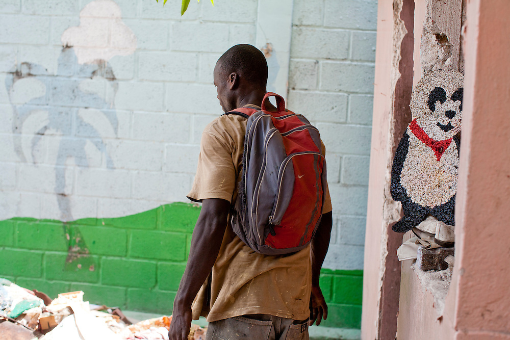 A man stands amid rubble from a former school on July 7, 2010 in Port-au-Prince, Haiti.