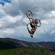 SHOT 7/29/11 4:00:56 PM - Eric Lawrenuk gets inverted off a jump during slopestyle qualifiers at Crankworx Colorado at the Trestle Bike Park in Winter Park, Co. Lawrenuk finished 13th in the event with a score of 78.00. The event is a Pro-am mountain bike competition featuring a dual slalom race, the Trestle Unchained Challenge, slopestyle and cross country racing events where top pros competed for more than $35,000 in prize money. (Photo by Marc Piscotty / © 2011)