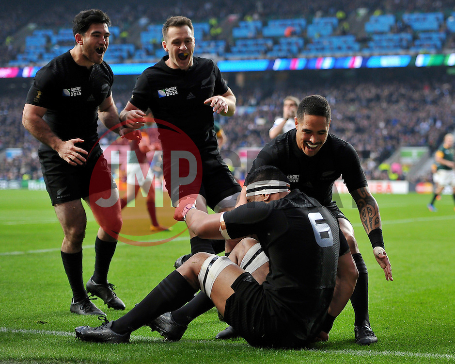 Jerome Kaino of New Zealand is congatulated by New Zealand players on his try - Mandatory byline: Patrick Khachfe/JMP - 07966 386802 - 24/10/2015 - RUGBY UNION - Twickenham Stadium - London, England - South Africa v New Zealand - Rugby World Cup 2015 Semi Final.