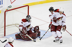 Mar 12, 2009; Newark, NJ, USA; New Jersey Devils center Travis Zajac (19) scores a goal against Phoenix Coyotes goalie Josh Tordjman (42) during the third period at the Prudential Center. The Devils defeated the Coyotes 5-2, and New Jersey Devils goalie Martin Brodeur (30) moved to within one win of tying Patrick Roy for the all-time win record.