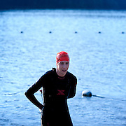 Cathryn Taylor - first woman out of the water.  Best in the West Triathlon.  Half Ironman Triathlon at Foster Lake on 10 September 2011, Sweet Home, Oregon.