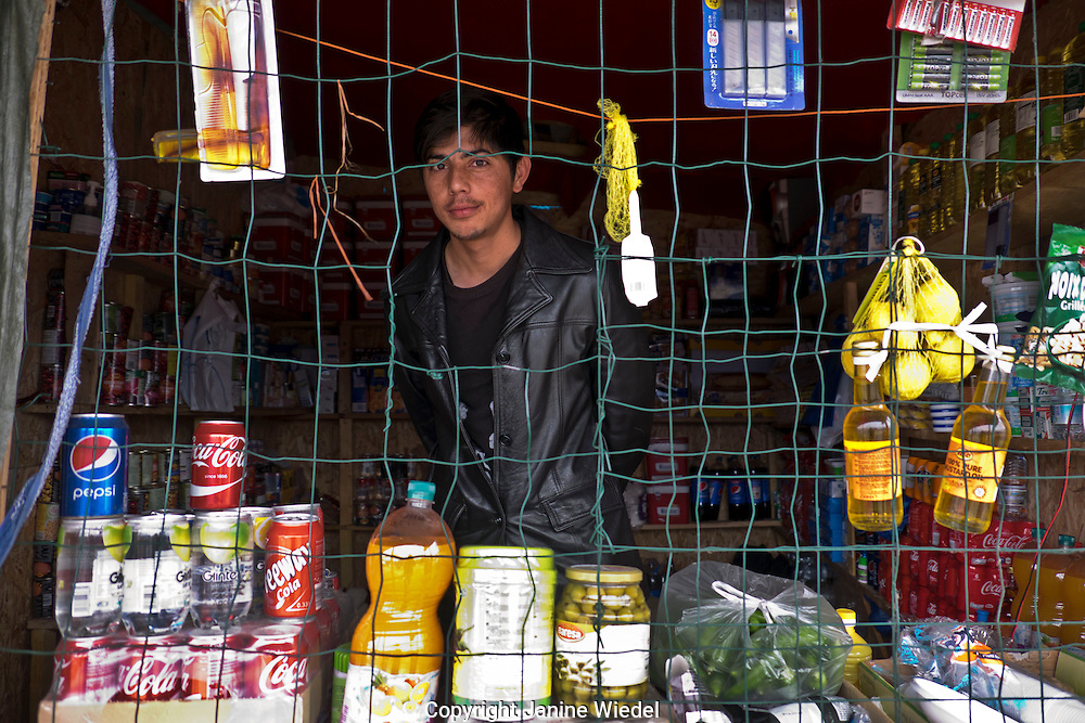 Shopkeeper selling general supplies in The Calais Jungle Refugee and Migrant Camp in Francei