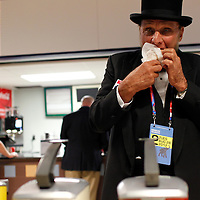 A man dressed as Abraham Lincoln stops for a hot dog at the RNC at the Tampa Bay Times Forum.