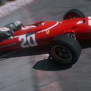 Formula 1 driver Chris Amon of New Zealand driving a Ferrari at the Gazomètre hairpin at the Monaco Grand Prix in 1967.