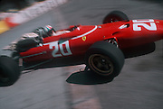 Formula 1 driver Chris Amon of New Zealand driving a Ferrari at the Gazomètre hairpin at the Monaco Grand Prix in 1967.