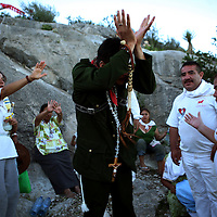 A curandero, or faith healer, believed to have healing powers when possessed, and dressed as notorious Mexican bandit Pancho Villa, conducts a healing session just outside of Espinazo, Mexico on Wednesday, October 18, 2006. Espinazo became famous because of a famed faith healer called Nino Fidencio. Fidencio died in 1938, but twice a year followers come to the small village to give thanks and pray. Many look to be healed by modern followers of Nino Fidencio--faith healers from throughout the region who claim to be possessed by the late healer and then endowed with his legendary healing powers.  His believers, an estimated 20,000, gather in his hometown for a three-day festival twice a year in March and October. (Photo/Scott Dalton)